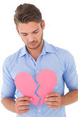 Young man holding broken heart — Foto Stock