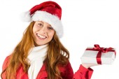 Festive redhead holding a gift — Stock Photo