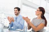 Business people applauding at meeting — Foto Stock