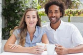 Happy couple having coffee together — Foto Stock