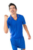 Athletic football player cheering — Stock Photo