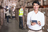 Warehouse manager using calculator — Stockfoto