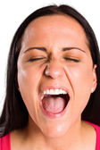 Angry young brunette shouting in close up — Stock Photo