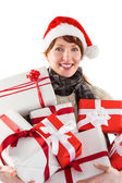 Woman holding lots of presents — Stock Photo