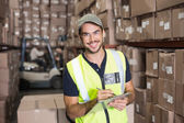 Warehouse worker with clipboard — Stock Photo