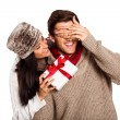 Young woman giving gift to boyfriend — Stock Photo #53920009