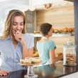 Pretty blonde being tempted by cupcakes — Stock Photo #53920165