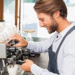 Handsome barista making a cup of coffee — Stock Photo #53920193