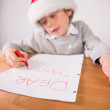Child writing letter to santa — Stock Photo #53920351