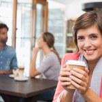 Pretty brunette enjoying her coffee — Stock Photo #53920447