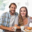 Happy couple enjoying a coffee — Stock Photo #53920511