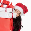 Woman holding many christmas presents — Stock Photo #53920603