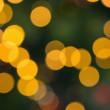 Blurry yellow christmas light circles — Stock Photo #53920937