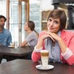 Pretty brunette enjoying her latte — Stock Photo #53922029