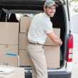 Delivery driver loading his van with boxes — Stock Photo #53923237