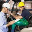 Warehouse manager talking with forklift driver — Stock Photo #53923575