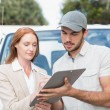 Delivery driver showing where to sign to customer — Stock Photo #53923739