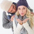 Attractive young couple in warm clothing — Stock Photo #53923819