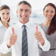Smiling businessman giving thumbs up — Stock Photo #53924093