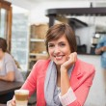 Pretty brunette enjoying her latte — Stock Photo #53924307