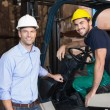 Warehouse manager with forklift driver — Stock Photo #53924987