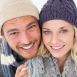 Attractive young couple in warm clothing — Stock Photo #53925055