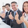 Business team all giving thumbs up — Stock Photo #53925101