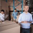 Warehouse manager using his tablet pc — Stock Photo #53925389