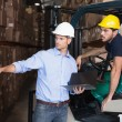 Warehouse manager talking with forklift driver — Stock Photo #53925897