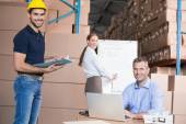 Warehouse team working together on shipment — Stock Photo