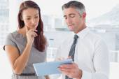Business people comparing work notes — Stock Photo