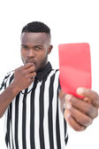 Serious referee showing red card — Stockfoto