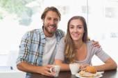 Happy couple enjoying a coffee — Stock Photo