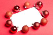 White page surrounded by christmas baubles — Stockfoto
