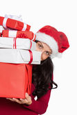 Woman holding many christmas presents — Stock Photo