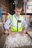 Warehouse worker preparing shipmentin — Stock Photo