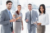 Business team having some drinks — Stock Photo
