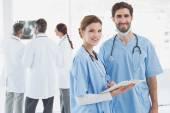 Nurses holding a file together — Stock Photo