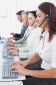 Employee's typing on their computers — Stock Photo