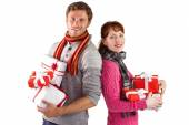 Couple holding lots of presents — Stock Photo