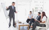 Empresário dando uma apresentação — Fotografia Stock