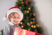 Child opening his christmas present — ストック写真