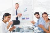 Business people applauding at meeting — Stock Photo