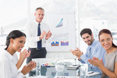 Business people applauding at meeting — Stockfoto