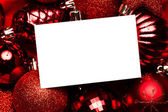White page on red christmas baubles — Foto de Stock
