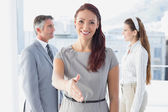 Smiling business woman offering handshake — Stock Photo