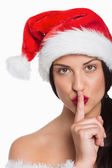 Woman with finger against lips — Foto Stock