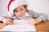 Child writing letter to santa — Foto de Stock