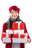 Smiling woman holding large presents — Stockfoto