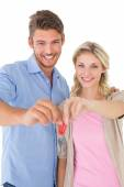Young couple holding new house key — Stock Photo
